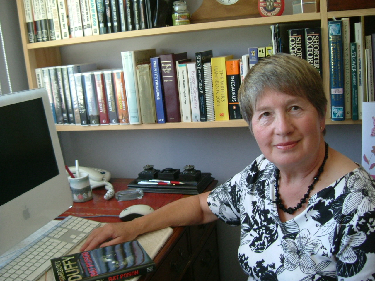 Portrait of Margaret at her writing desk